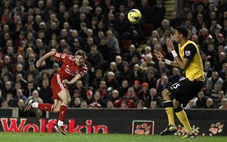 Liverpool's Steven Gerrard (L) shoots at goal during their English Premier League soccer match against Blackburn Rovers at Anfield in Liverpool, northern England, December 26, 2011. REUTERS/Phil Noble