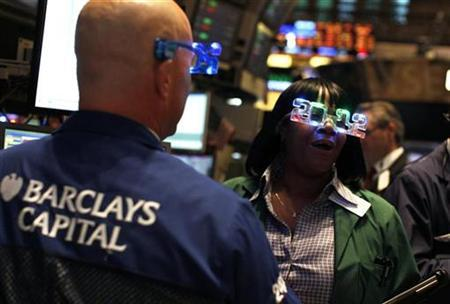 Traders wear '2012' glasses as they work on the main trading floor of the New York Stock Exchange during the final trading day of 2011 in New York December 30, 2011. REUTERS/Mike Segar