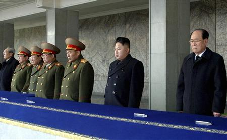 North Korea's new leader Kim Jong-un (2nd R) looks on, as he is flanked by President of the Presidium of the Supreme People's Assembly of North Korea Kim Yong-nam (R) and Chief of General Staff of the Korea People's Army Ri Yong-ho (3rd R), during the memorial for late North Korean leader Kim Jong-il in Pyongyang, in this KCNA picture taken on December 29, 2011 and released on December 30, 2011.   REUTERS/KCNA