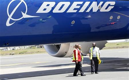 Engineers stand next to the Boeing Dreamliner 787-800 after making its first landing at the Jomo Kenyatta airport in Kenya's capital Nairobi, December 14, 2011.   REUTERS/Thomas Mukoya
