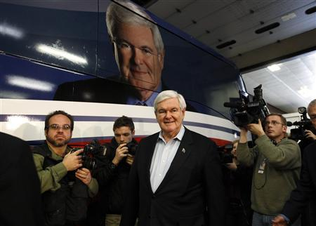 U.S. Republican presidential candidate and former U.S. House Speaker Newt Gingrich arrives to meet with employees of the Atlantic Bottling Company in Atlantic, Iowa December 31, 2011.  REUTERS/Jeff Haynes
