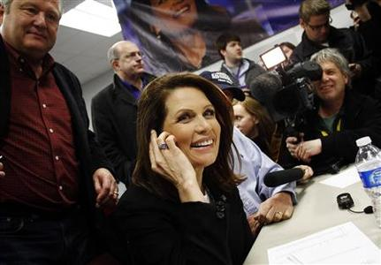 Republican presidential candidate and Representative Michele Bachmann makes a campaign phone call to a supporter from her office in Urbandale, Iowa December 31, 2011. REUTERS/Joshua Lott
