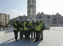 <p>Arab League observers speak to each other in Idlib December 30, 2011. Syrian security forces, undaunted by the presence of Arab League observers, have killed at least 12 protesters as hundreds of thousands demonstrated against the government of President Bashar al-Assad, opposition activists said. REUTERS/Handout</p>