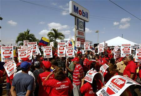 Supporters of Venezuelan President Hugo Chavez protest in front of Mobil service station in Maracaibo, February 12, 2008. REUTERS/Str