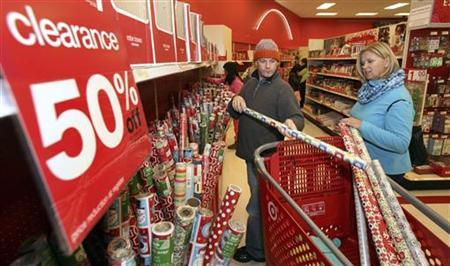 Robert and Yvonne McGillis of Oakland choose gift wraps, taking advantage of after-Christmas sales at a Target Store in the Bay Fair Mall in San Leandro, California December 26, 2011.  REUTERS/Dino Vournas