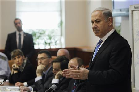 Israel's Prime Minister Benjamin Netanyahu (R) speaks during the weekly cabinet meeting in Jerusalem January 1, 2012. REUTERS/Ronen Zvulun