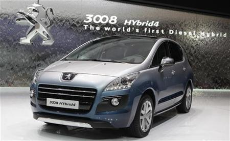 A new Peugeot 3008 Hybrid4 hybrid car is displayed during the first media day of the 81st Geneva International Motor Show at the Palexpo in Geneva March 1, 2011. REUTERS/Denis Balibouse