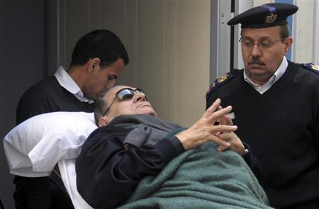 Former Egyptian president Hosni Mubarak lies on a gurney bed while leaving the courtroom at the police academy in Cairo, January 2, 2012. REUTERS/Stringer