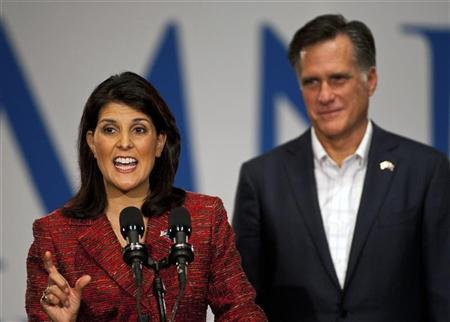 South Carolina Governor Nikki Haley (L) speaks as U.S. Republican presidential candidate and former Massachusetts Governor Mitt Romney (R) looks on during a rally in Greenville, South Carolina December 16, 2011. REUTERS/Chris Keane