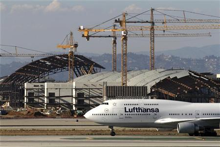 A Lufthansa Boeing 747 jet taxis in front of the ongoing billion-dollar expansion and refurbishment project at Tom Bradley International Terminal at Los Angeles International Airport September 7, 2011.  REUTERS/Jonathan Alcorn