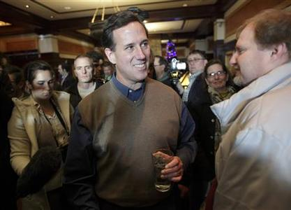 Republican presidential candidate Rick Santorum campaigns at The Hotel Pattee in Perry, Iowa, January 2, 2012. REUTERS/John Gress