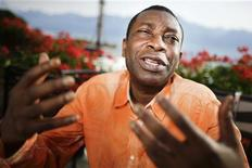 Senegalese singer Youssou N'Dour gestures during an interview with Reuters before his concert at the 44th Montreux Jazz Festival in Montreux July 9, 2010. REUTERS/Valentin Flauraud
