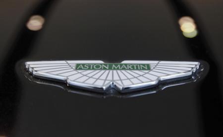 The logo of Aston Martin is seen on a car inside the company's showroom in Mumbai January 2, 2012. REUTERS/Danish Siddiqui