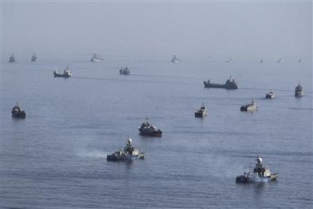 Iranian ships participate in a naval parade on the last day of the Velayat-90 war game on the Sea of Oman near the Strait of Hormuz in southern Iran, January 3, 2012. REUTERS/Jamejamonline/Ebrahim Norouzi
