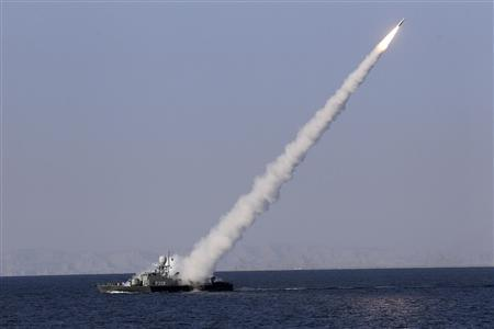 A new medium-range missile is fired from a naval ship during Velayat-90 war game on Sea of Oman near the Strait of Hormuz in southern Iran January 1, 2012. REUTERS/Jamejamonline/Ebrahim Norouzi