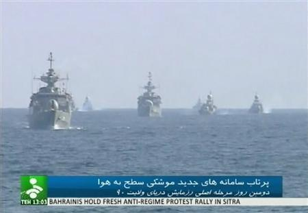 Iranian warships take part in a naval drill in an unknown location in this still image taken from footage released by Islamic Republic of Iran News Network on January 1, 2012.  REUTERS/IRINN via Reuters TV