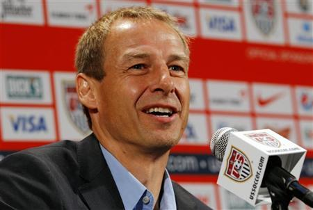 Former German soccer star Juergen Klinsmann speaks at a news conference after being named as the new head coach of the United States men's national soccer team in New York,  August 1, 2011.  REUTERS/Mike Segar