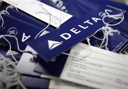 Delta airline name tags are seen at Delta terminal in JFK Airport in New York in this July 30, 2008 file photo. REUTERS/Joshua Lott