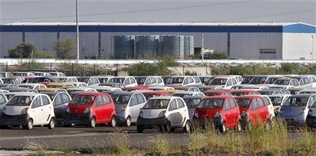 Tata Nano automobiles are seen parked at the carmaker's plant in Sanand, Gujarat state, September 26, 2011.   REUTERS/Amit Dave