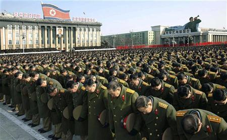 North Koreans gather during a memorial for the late North Korean leader Kim Jong-il in Pyongyang, in this KCNA picture released December 29, 2011. North Korea's military staged a huge funeral procession on Wednesday in the snowy streets of the capital Pyongyang for its deceased ''dear leader,'' Kim Jong-il, readying a transition to his son, Kim Jong-un.      REUTERS/KCNA  THIS IMAGE HAS BEEN SUPPLIED BY A THIRD PARTY. IT IS DISTRIBUTED, EXACTLY AS RECEIVED BY REUTERS, AS A SERVICE TO CLIENTS. NO THIRD PARTY SALES. NOT FOR USE BY REUTERS THIRD PARTY DISTRIBUTORS