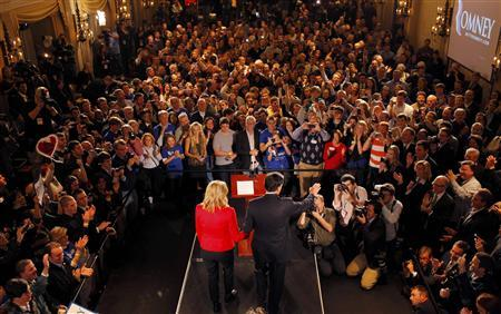 Mitt Romney holds hands with his wife Ann as he addresses supporters at his Iowa Caucus night rally in Des Moines, January 3, 2012. REUTERS/Brian Snyder