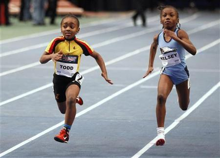 Kendra Todd (L) and Zarah Kelsey compete in the girls 50 meter fastest kid on the block race at the 104th Millrose Games at Madison Square Garden in New York January 28, 2011. REUTERS/Shannon Stapleton