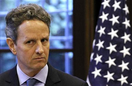 U.S. Treasury Secretary Timothy Geithner looks on during news conference with Italian Prime Minister Mario Monti in Milan, December 8, 2011.    REUTERS/Alessandro Garofalo