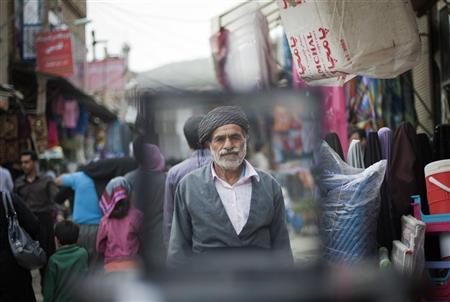 An Iranian Sunni Kurd walks at a bazaar while shopping in Marivan in Kurdistan province, 512 km (318 miles) west of Tehran, May 12, 2011. Iranian Shi'ite and Sunni Kurds live in harmony with each other in Marivan, although Sunni is the religion of the majority of the people. REUTERS/Morteza Nikoubazl