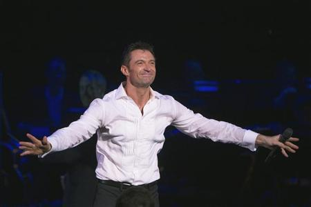 Actor Hugh Jackman acknowledges applause during a curtain call for his Broadway play ''Hugh Jackman, Back on Broadway,'' in New York November 10, 2011. REUTERS/Lucas Jackson
