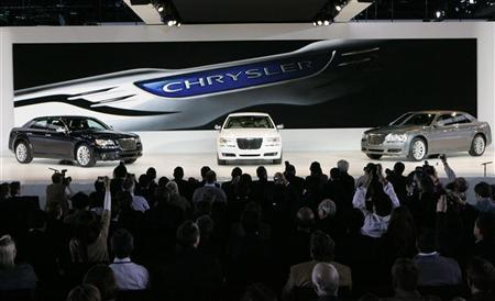 Chrysler 300 cars are displayed on stage during the press day for the North American International Auto show in Detroit, Michigan January 10, 2011. REUTERS/Rebecca Cook