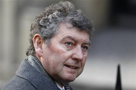 Former News of the World editor Colin Myler arrives to give evidence at the Leveson Inquiry into media practices at the High Court in central London in this December 14, 2011 file photo. REUTERS/Suzanne Plunkett/Files