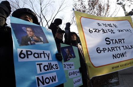 Pro-unification activists chant slogans at a rally denouncing the United States and South Korean government's policy toward North Korea in front of the foreign ministry in Seoul January 5, 2012, while the U.S. assistant secretary of state for East Asian and Pacific Affairs Kurt Campbell visits the ministry to meet South Korean officials.  REUTERS/Kim Hong-Ji