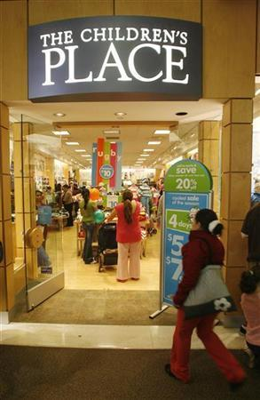 A shopper walks into the Children's Place, which sells children's clothes, at the Glendale Galleria shopping mall on Black Friday in Glendale, California November 28, 2008. REUTERS/Fred Prouser