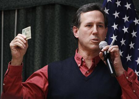 Rick Santorum holds a $20 dollar bill during a campaign stop at Rockingham County Nursing Home in Brentwood, New Hampshire, January 4, 2012.  REUTERS/Shannon Stapleton