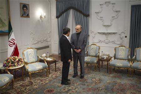 Iran's Foreign Minister Ali Akbar Salehi (R) speaks with Iranian President Mahmoud Ahmadinejad before an official meeting with Turkey's Foreign Minister Ahmet Davutoglu in Tehran January 5, 2012. REUTERS/Morteza Nikoubazl