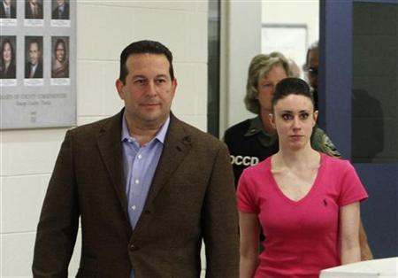 Casey Anthony and her lawyer Jose Baez (L) leave the Orange County Jail in Orlando, Florida July 17, 2011.   REUTERS/Red Huber/Pool