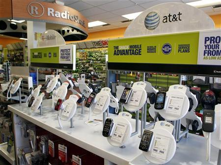 AT&T mobile phones are seen for sale alongside T-Mobile phones at a RadioShack electronics store in Los Angeles August 31, 2011.   REUTERS/Danny Moloshok