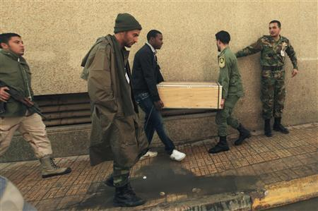 Members of the Libyan National Army carry a cash box for distribution of unpaid salaries to military personnel stationed in various camps, in Benghazi January 5, 2012. REUTERS/Esam Al-Fetori