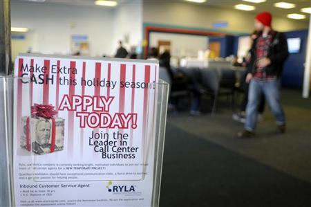 A flyer advertising holiday job listings is seen at the North Metro Department of Labor Career Center in Atlanta, Georgia, December 1, 2011. REUTERS/Tami Chappell