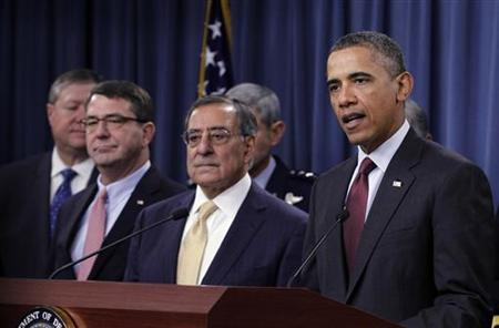 U.S. President Barack Obama delivers remarks on the Defense Strategic Review at the Pentagon near Washington, January 5, 2012. With Obama are (front row, L-R) Deputy Secretary of Defense Ashton Carter and Secretary of Defense Leon Panetta. REUTERS/Jason Reed