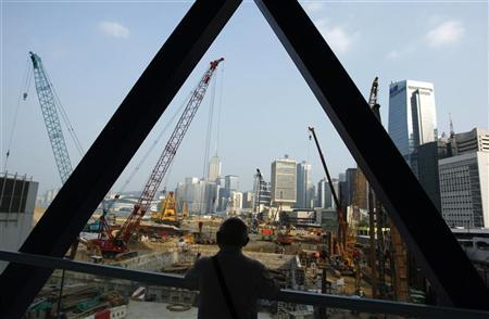 A man looks at construction works at Hong Kong's financial Central district October 16, 2008. REUTERS/Bobby Yip/Files