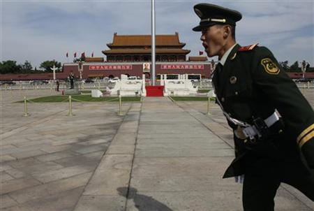 A paramilitary policeman prevents a visitor entering the blocked area around national flag pole at Tiananmen Square, in Beijing, October 14, 2011. REUTERS/Jason Lee/Files