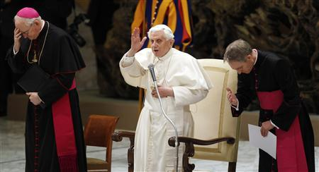 Pope Benedict XVI blesses as he leads the general audience in Saint Paul VI's Hall at the Vatican January 4, 2012.   REUTERS/Max Rossi