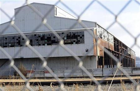 An abandoned building from the bankrupt GST Steel Company is a silent memorial to a dead industry in Kansas City, Missouri December 15, 2011. REUTERS/Dave Kaup