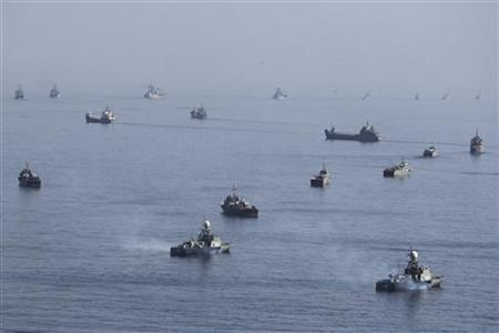 Iranian ships participate in a naval parade on the last day of the Velayat-90 war game on the Sea of Oman near the Strait of Hormuz in southern Iran January 3, 2012. REUTERS/Jamejamonline/Ebrahim Norouzi