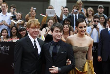 Cast members (L-R) Rupert Grint, Daniel Radcliffe and Emma Watson arrive for the premiere of the film ''Harry Potter and the Deathly Hallows: Part 2'' in New York July 11, 2011. REUTERS/Lucas Jackson