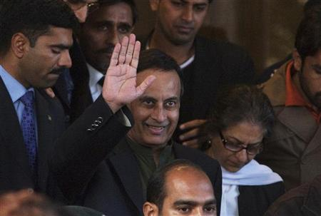 Former Pakistani ambassador to the U.S. Hussain Haqqani waves to media as he leaves the Supreme Court building after meeting his lawyer in Islamabad December 22, 2011.  REUTERS/Faisal Mahmood