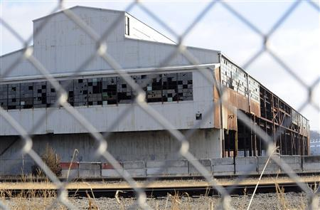 An abandoned building from the bankrupt GST Steel Company is a silent memorial to a dead industry in Kansas City, December 15, 2011.  REUTERS/Dave Kaup