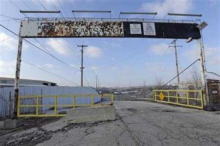 A weather-beaten entrance sign for the former ARMCO Steel Mill, which was bought by the now bankrupt GST Steel company is now a gateway for trucks bringing recycled steel for recycling in Kansas City, Missouri December 15, 2011. REUTERS/Dave Kaup
