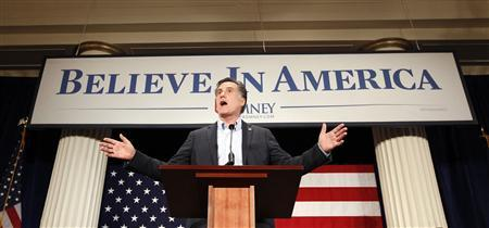 Mitt Romney delivers remarks in the Gold Room at the Hotel Blackhawk in Davenport, Iowa, December 27, 2011. REUTERS/Jeff Haynes